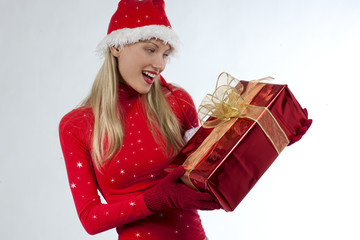 Attractive santa girl with presents