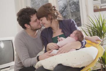 Junge Familie mit Baby, Säugling