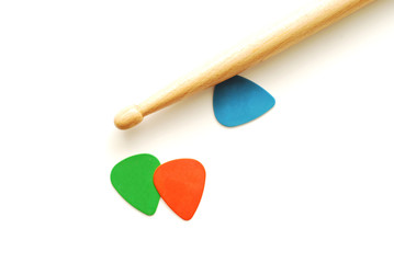 drumstick and guitar picks