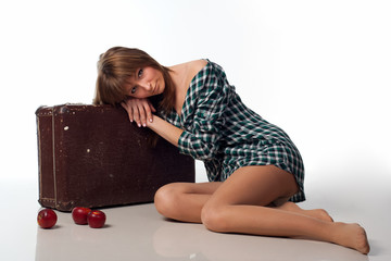 Young Sexy Woman lying with red apple and grunge case