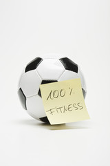 """soccer ball with sticky note """"100% fitness"""" separated"""
