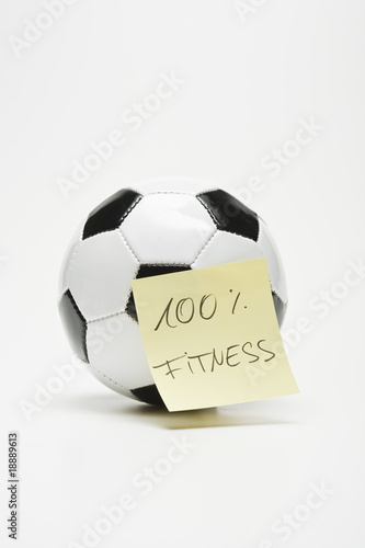"soccer ball with sticky note ""100% fitness"" separated"