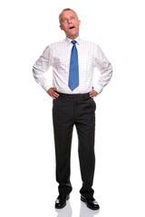 Mature businessman yawning full length portrait isolated.