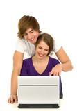 Teenage couple with laptop