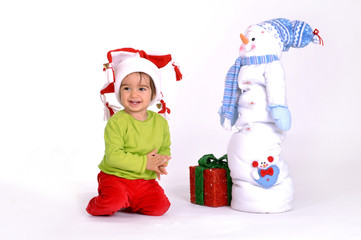 Cute baby with Christmas present
