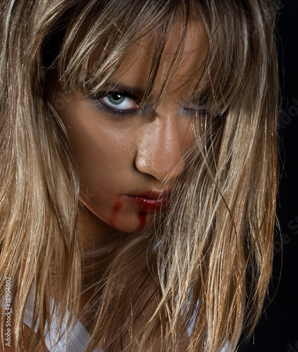 woman with bloody lips