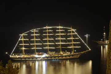 An old ship in the bay at night.