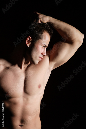 Sexy muscular man isolated on white