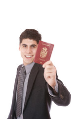 A businessman in a suit holds passport