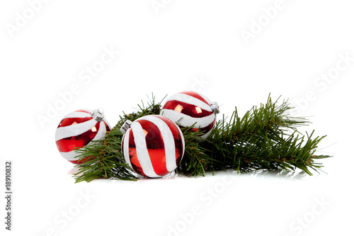 Red and white Christmas ornaments/baubles with pine branch