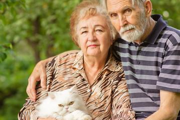 Elderly pair with Persian cat