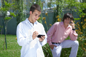 Two guys with mobile phones