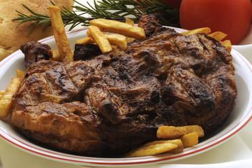 Pollo arrosto e patatine fritte