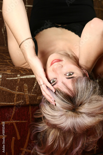 seductive woman lies on her back