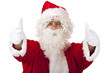 Santa Claus with Christmas fur cap shows thumbs - Nikolaus