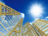 High modern skyscrapers, blue sky and sun
