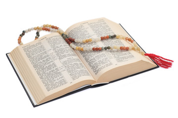 nephritic rosary over an holy bible.