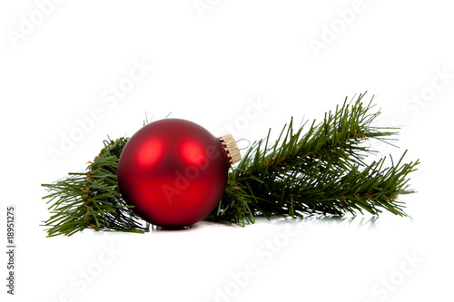 Red Christmas ornament/bauble with pine branch on white