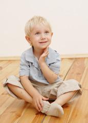 sitting little boy