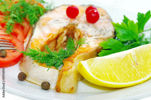 grilled fish with vegetables and slice of lemon