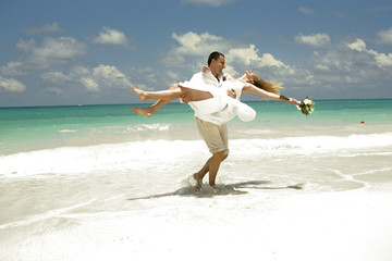 Wedding couple in Caribbean, by the sea.