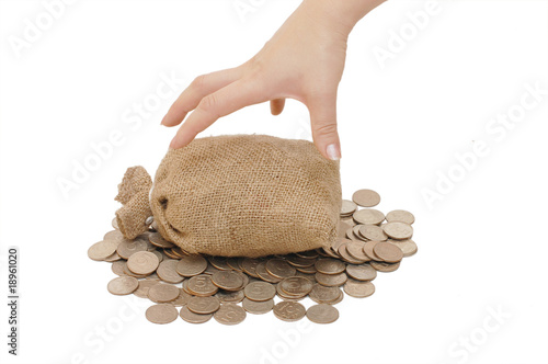 Hand reach for bags with coins isolated