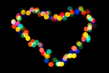 A heart made of colorful lights on black