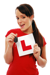 Excited girl holding car key and L plate