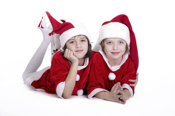 Two  little girls with Christmas costumes