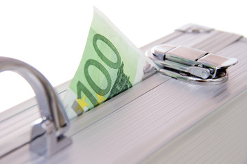 one hundred euro banknote sticking out of an aluminum suitcase