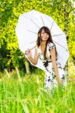 Girl under sun-protection umbrella