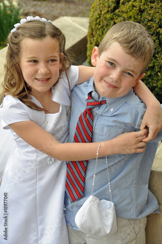 first communion day hug