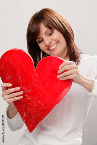 Happy woman repairing broken heart