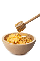 honey pouring over cornflakes isolated