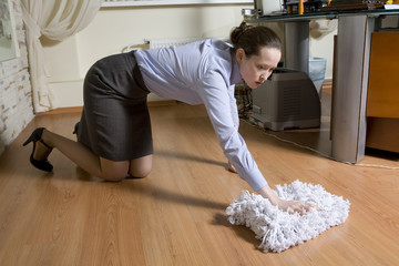 chief sacked cleaner. Secretary washes the floor