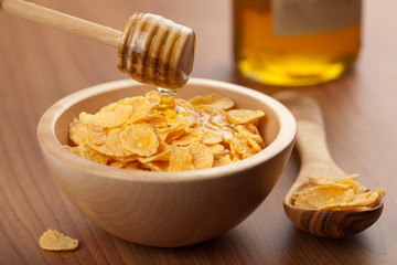 honey pouring over cornflakes