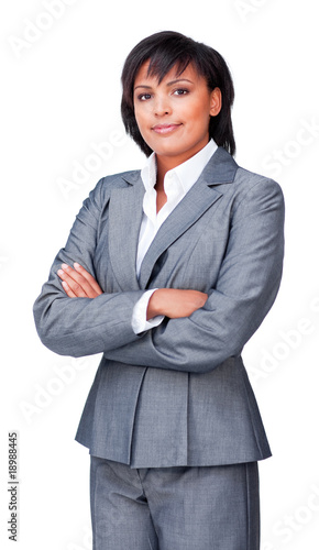 Portrait of a serious hispanic businesswoman with folded arms