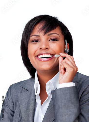 Businesswoman with headset on smiling at the camera