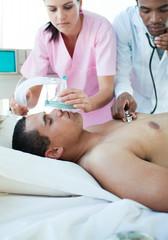 Nurse putting oxygen mask on a patient