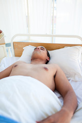 Young patient lying on a hospital bed