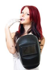 Attractive woman welder