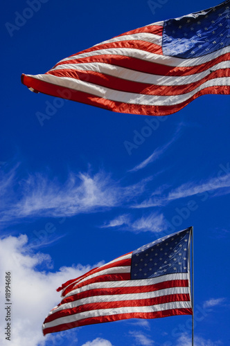 american flag in the wind on a blue sky