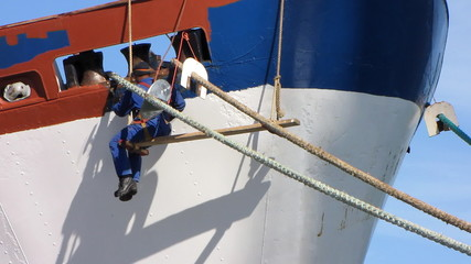 Shipyard worker repair the ship