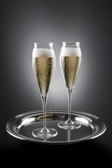 Two filled flutes of champagne