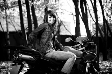 The fine girl on a beautiful motorcycle