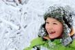 Happy boy in frozen forest