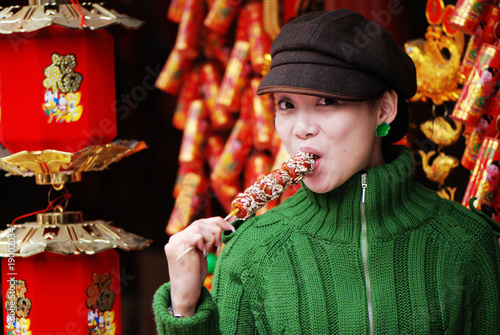 China girl eating candied fruit