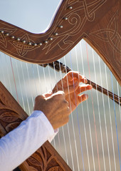 Harp being played by a Young Lady Closeup