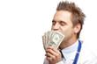 Happy male doctor kissing us dollar bills - Arzt küsst Geld