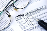 Working on the Income Tax 1040, isolated on white poster